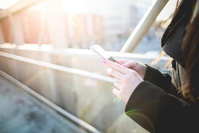 Woman Holding Smartphone Stock Photo