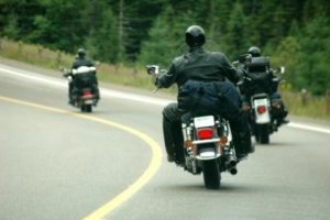 Motorcyclists Driving On The Road