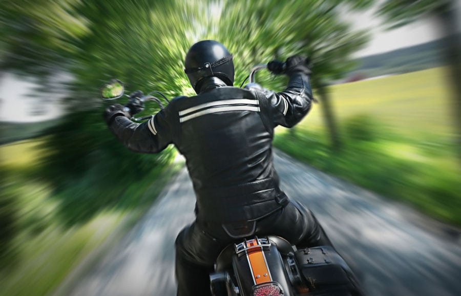 Man Riding Motorcycle Stock Photo