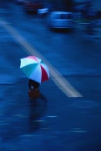 Pedestrian Carrying Colorful Umbrella