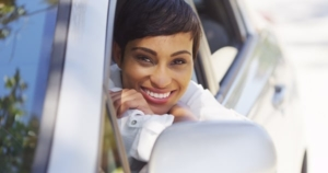 Woman Smiling In Car Stock Photo