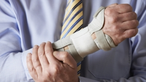 Businessman Suffering With Repetitive Strain Injury Stock Photo