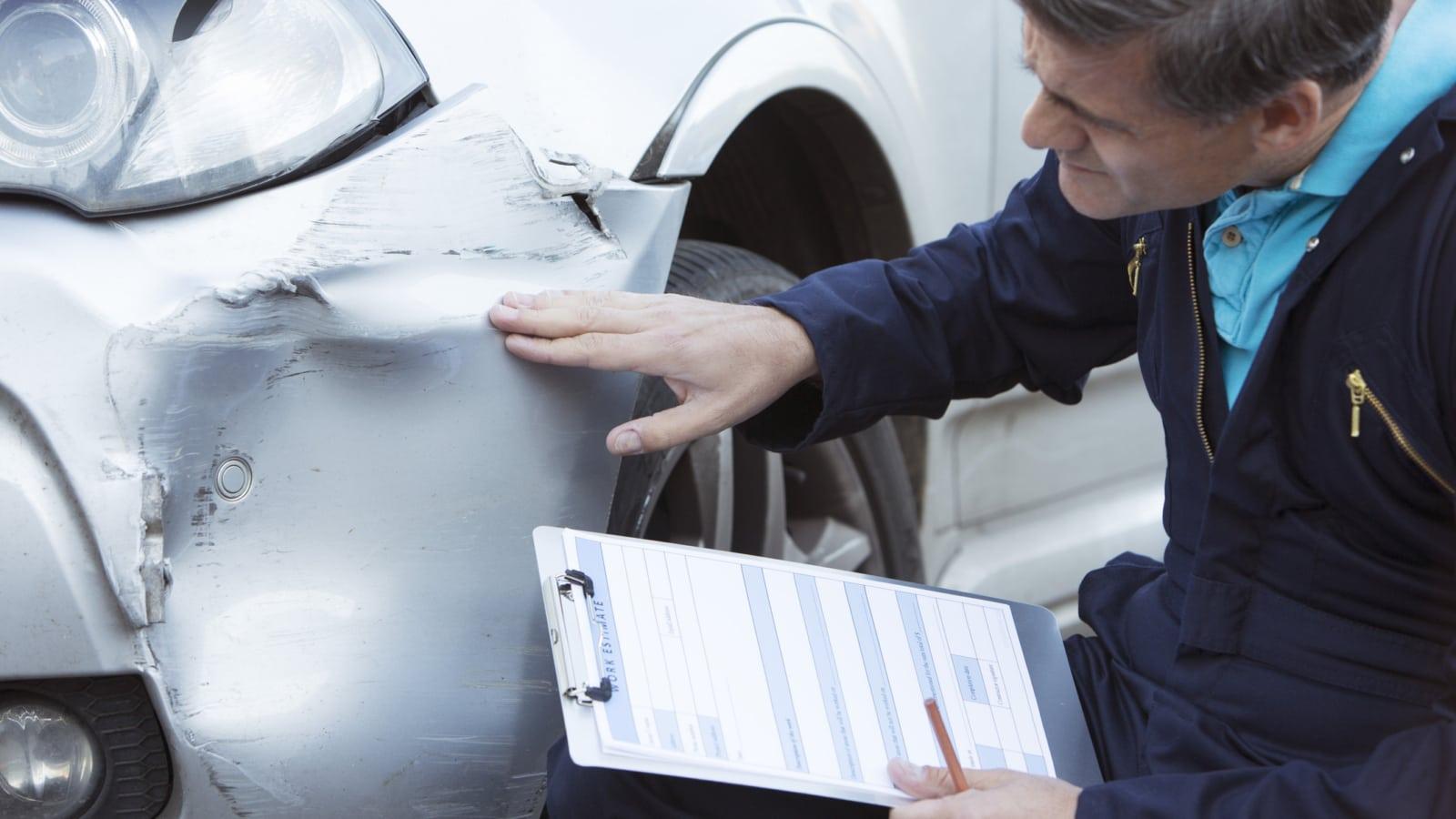 Mechanic Examining Car Stock Photo