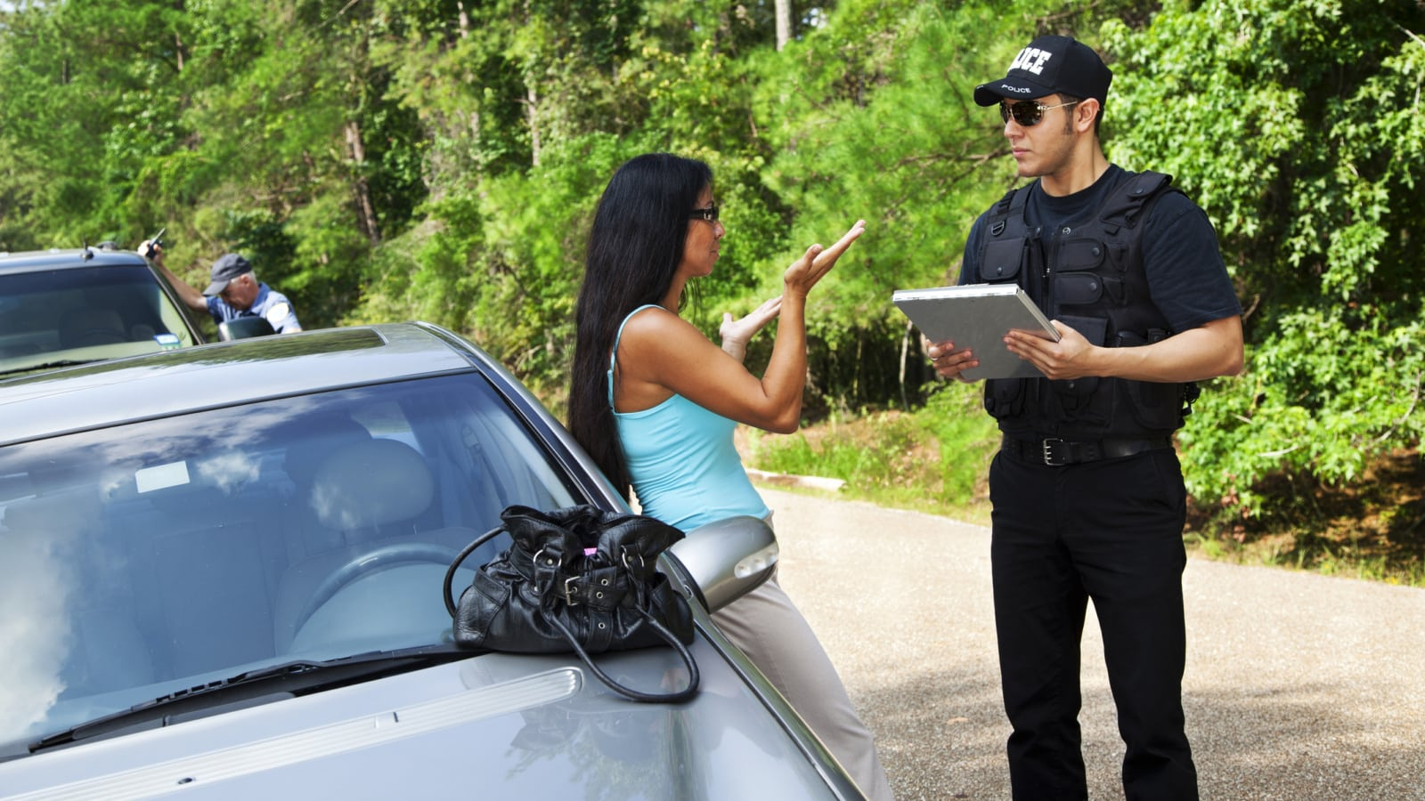 Woman Talking With Police Officer