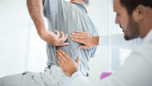 Chiropractor Lower Back Pain Stock Photo