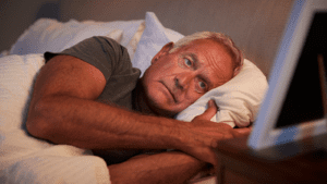 Elderly Man Sleeping Stock Photo