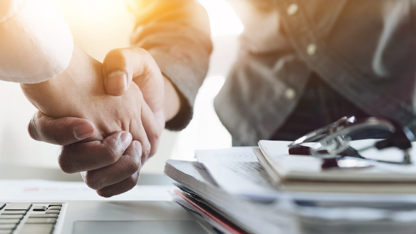Lawyer Shaking Hands With Client Stock Photo