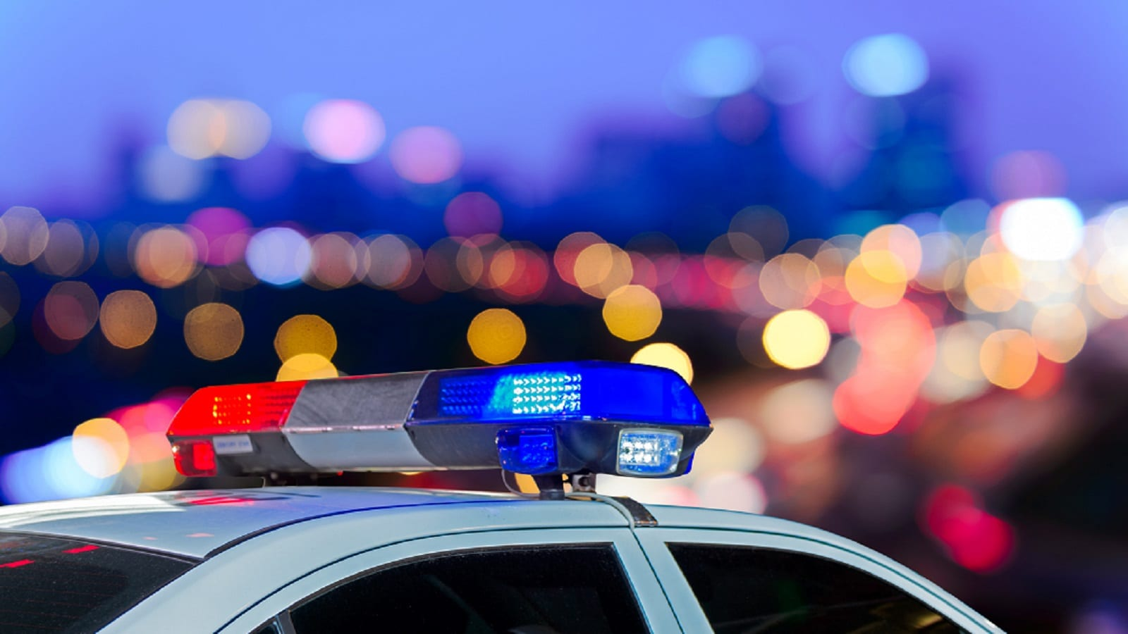 Parked Police Cruiser At Night Stock Photo