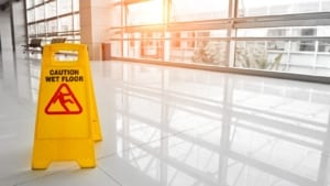 Caution Sign: Slippery Floor Stock Photo