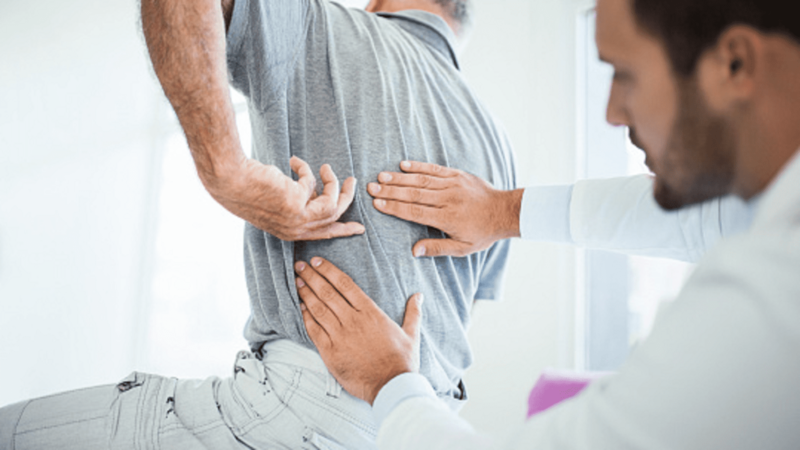 Man With Lower Back Pain Stock Photo