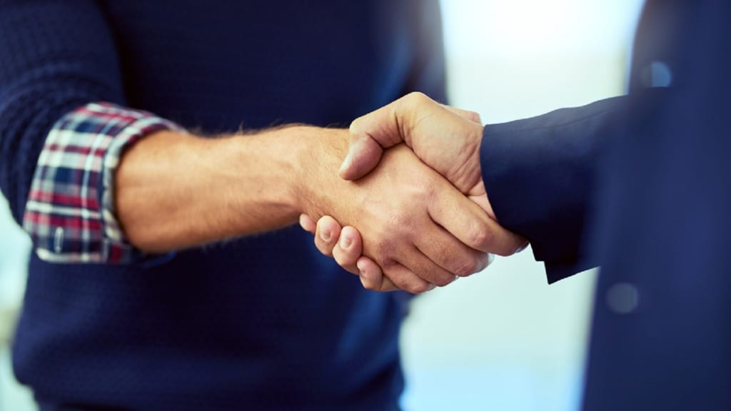 Lawyer Shaking Hands With A Client Stock Photo