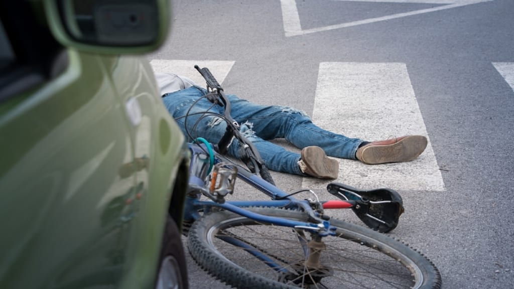 Injured Bicyclist Stock Photo