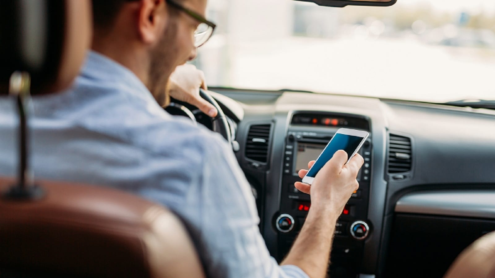 Young Man Texting While Driving Stock Photo