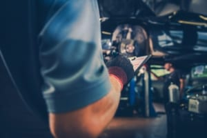 mechanic-going-through-car-maintenance-checklist