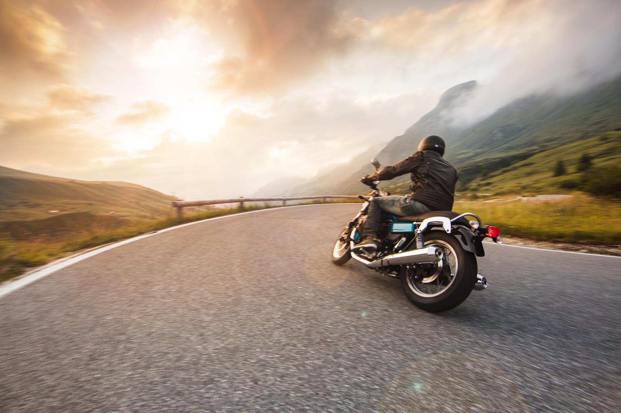 a man riding a motorcycle near Portland, ME