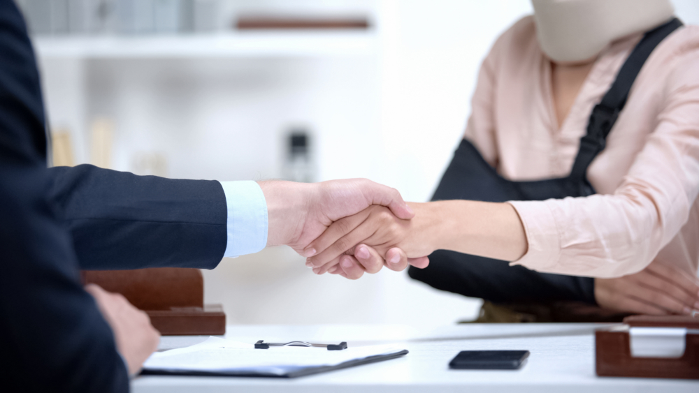 woman meeting with a Portland, ME, personal injury lawyer after an accident
