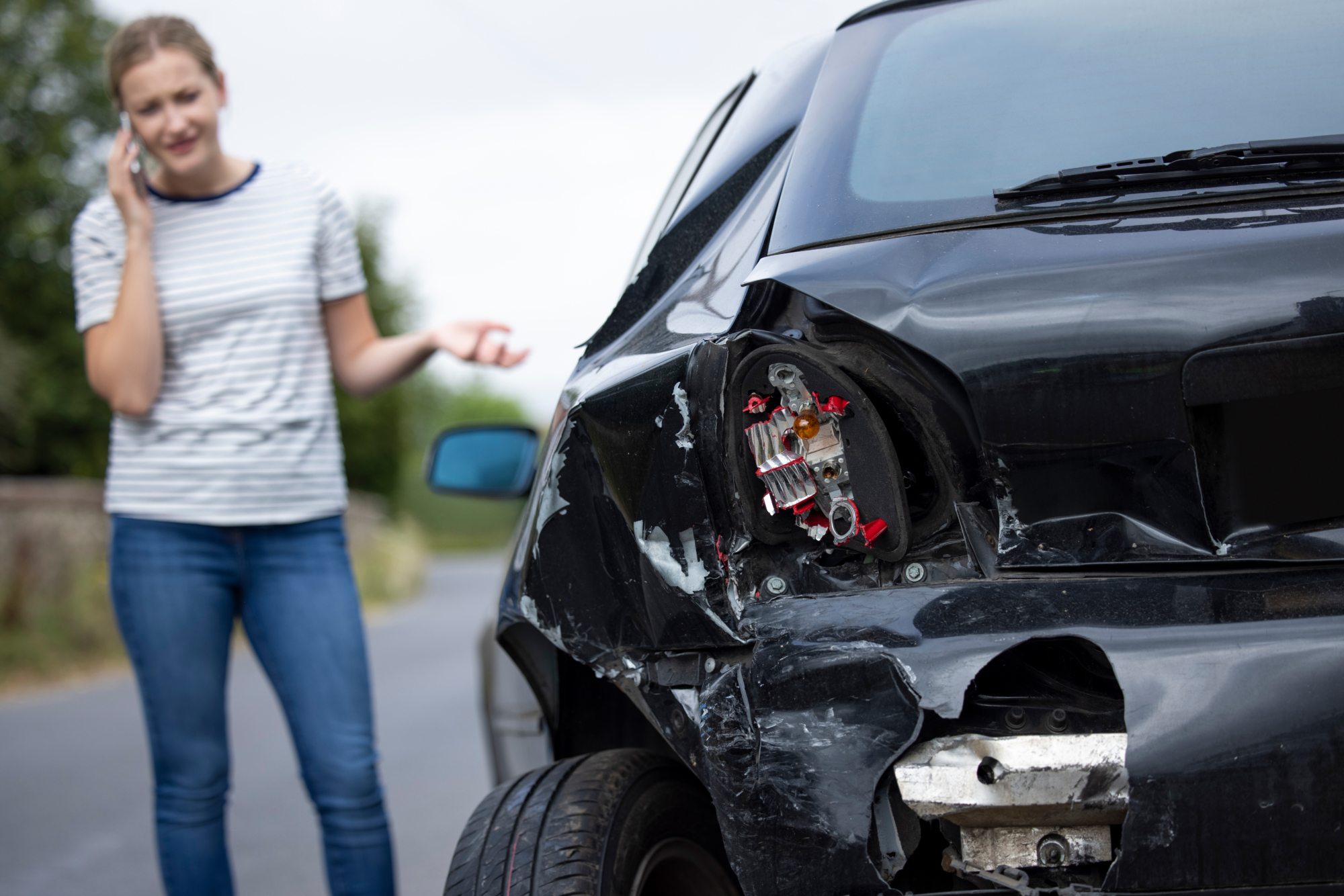 a woman calling a lawyer after a car accident in Bangor, ME