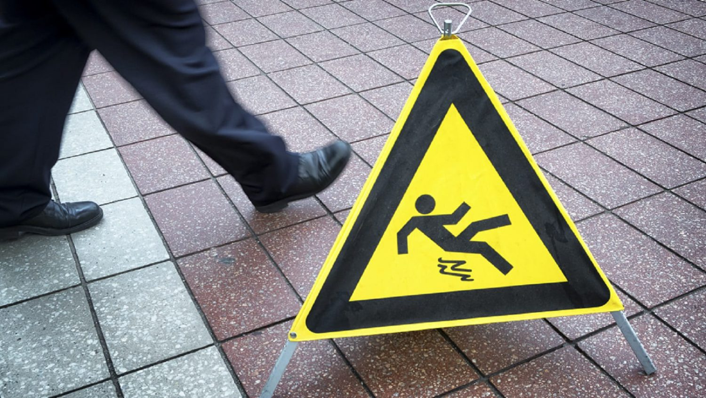Caution Slippery Sign Stock Photo