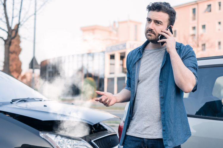 a man calling a car accident lawyer after an accident in Bangor, ME