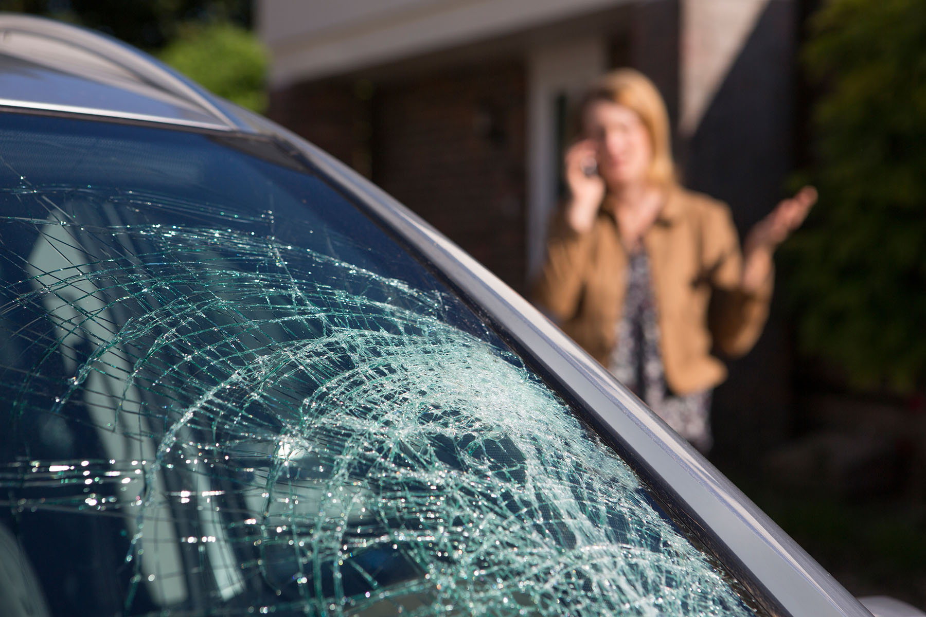 woman calling a car accident lawyer in Portland, ME