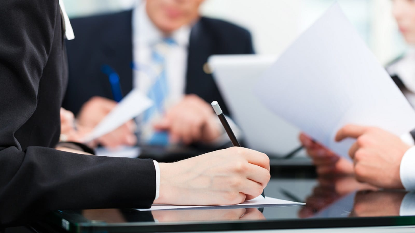 Lawyers Signing Legal Documents Stock Photo