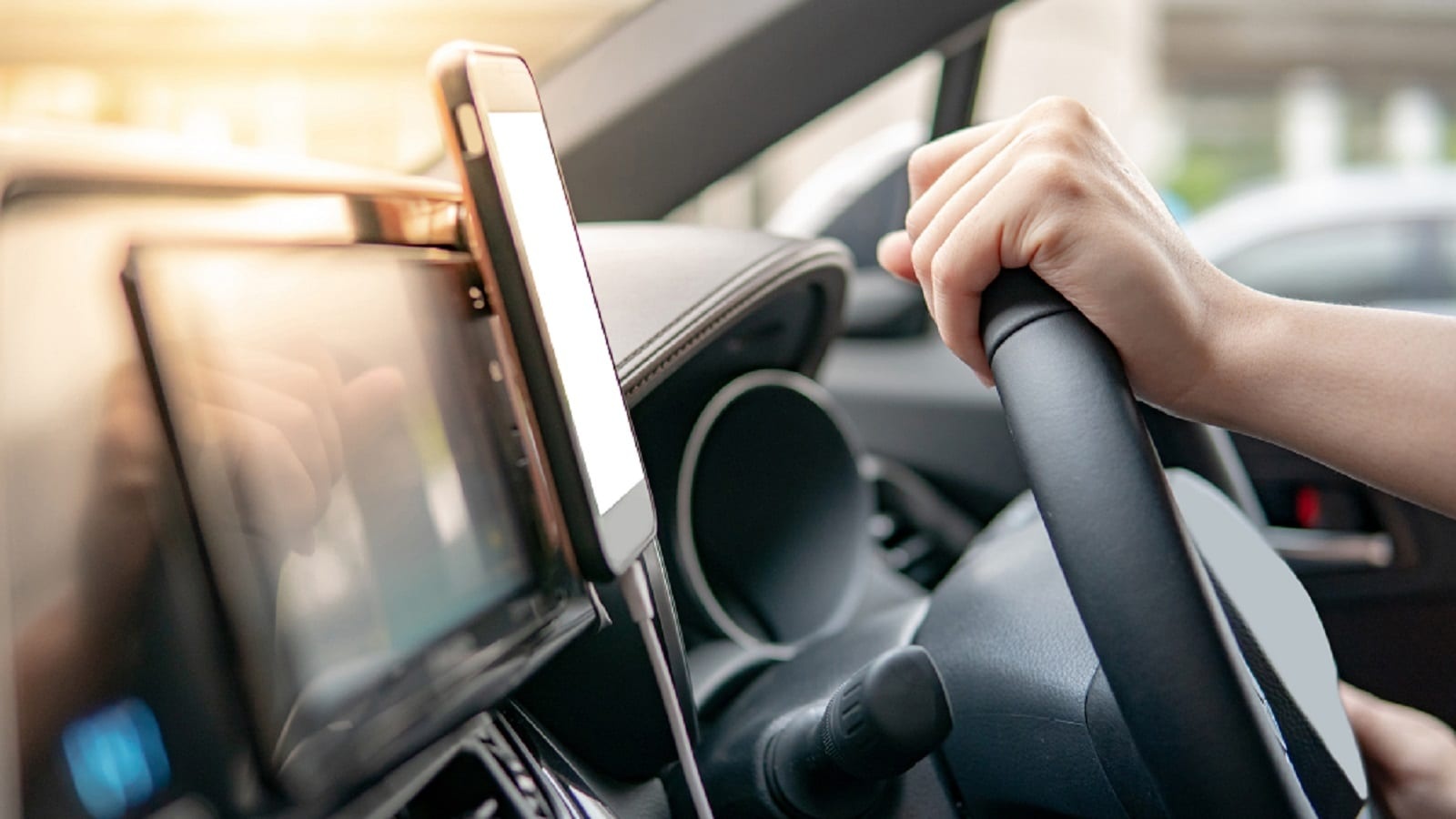 Mobile Device Holder On Dashboard Stock Photo