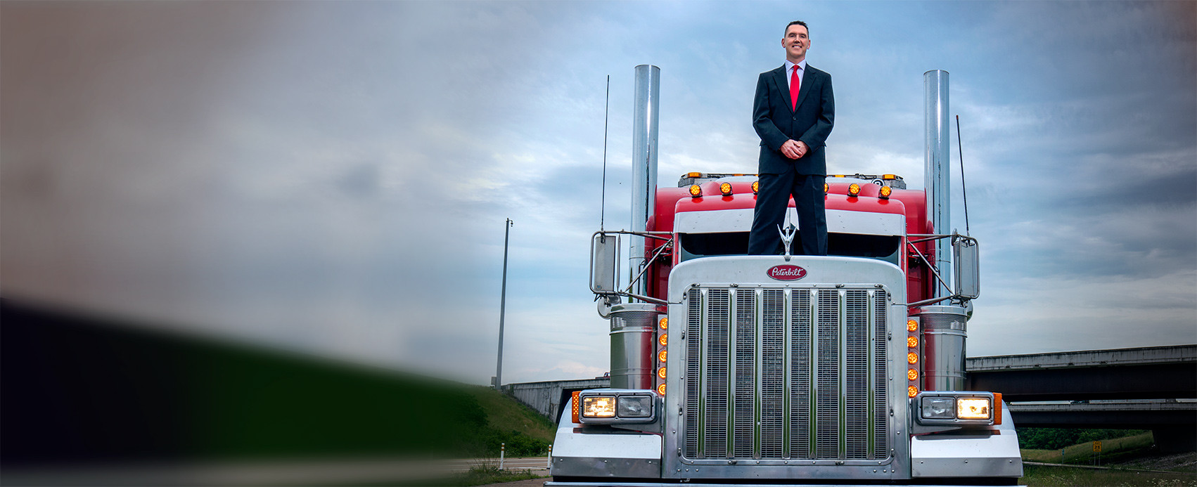 Attorney James Beardsley standing on top of big truck