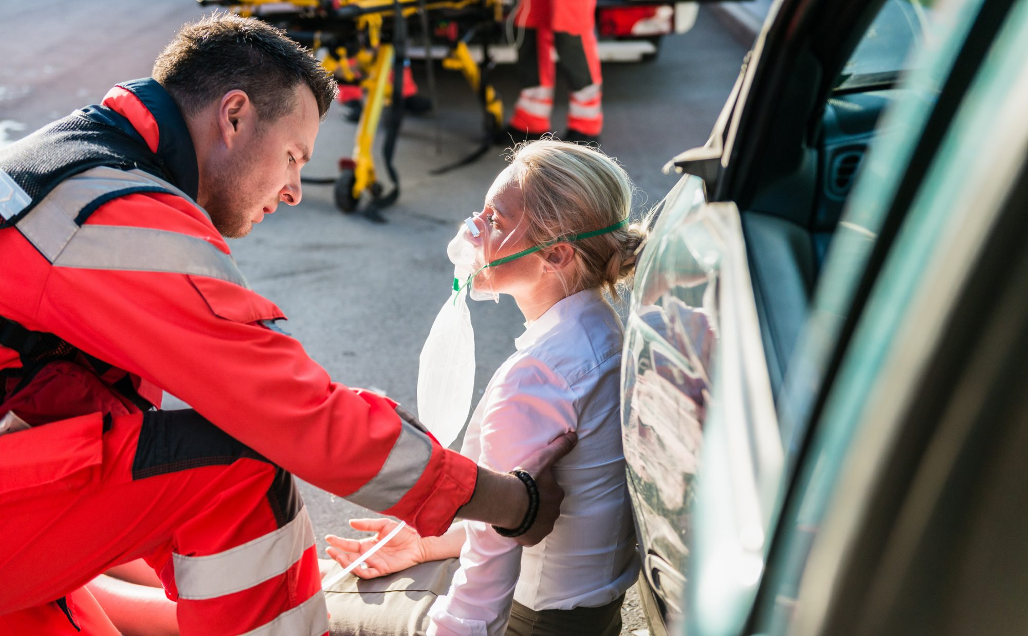 A woman being treated for injuries after a car accident.
